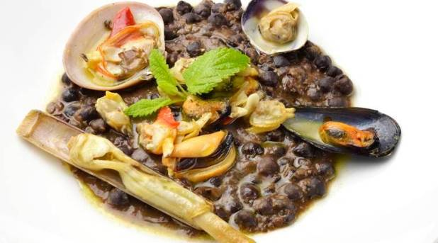 Fish dish Blacks chickpea soup with seafood