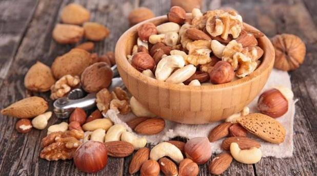 nuts, eating nuts, nuts heart disease, nuts cancer, heart disease, cancer risk, nut consumption, lifestyle news, health news, latest news, indian express
