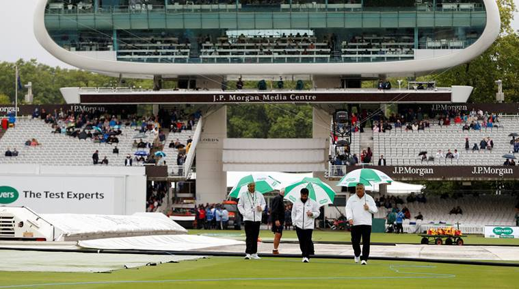 Umpires on the pitch during a rain delay at Lord's on Day 1 of second Test