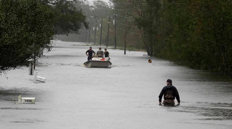 Florence death toll swells to 14 as rivers rise