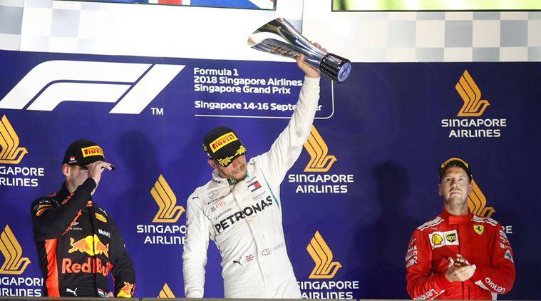 Mercedes' Lewis Hamilton celebrates on theÊpodiumÊafter winning the race alongside second placed Red Bull's Max Verstappen and third placed Ferrari's Sebastian Vettel