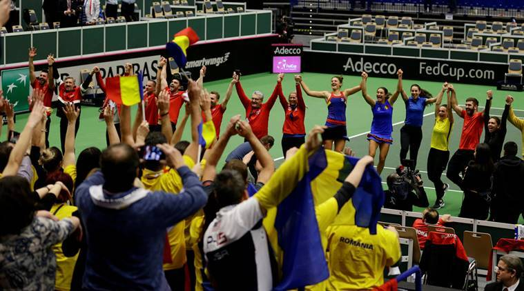 The Romania Fed Cup team celebrates with fans after beating Czech Republic