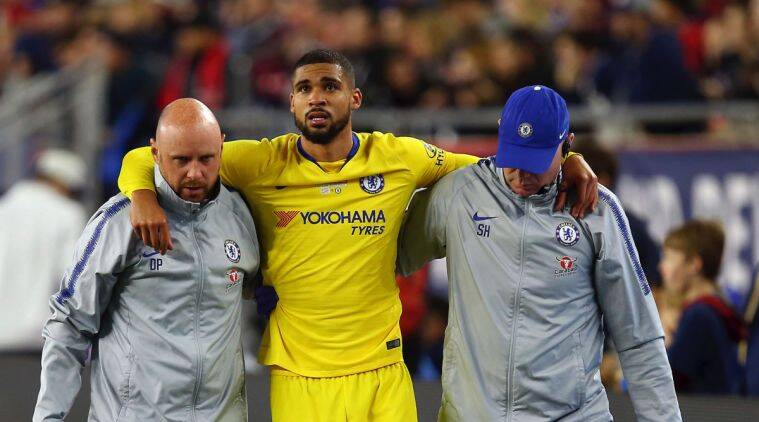 Chelsea's Ruben Loftus-Cheek, center, is helped off the field by training staff following an injury during the second half of a friendly soccer match against the New England Revolution