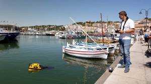 The Jellyfish sea-cleaning remote-controled catamaran is seen at work in the port of Cassis