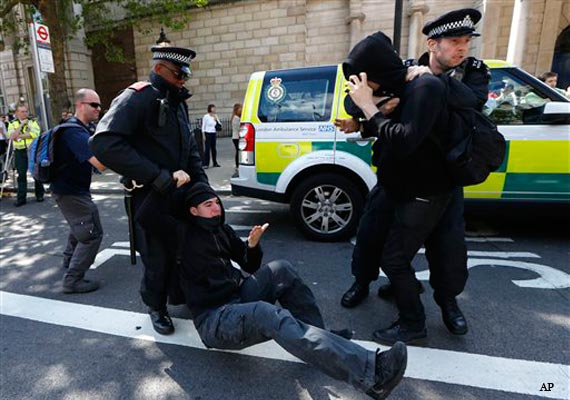 English Defence League supporters clash with police in London