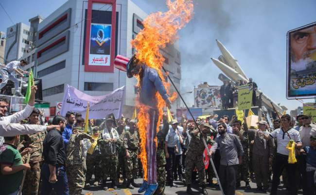A Scarecrow Model Is Set On Fire By Iranian