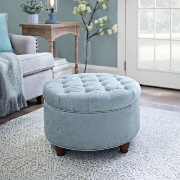 round blue tufted storage ottoman