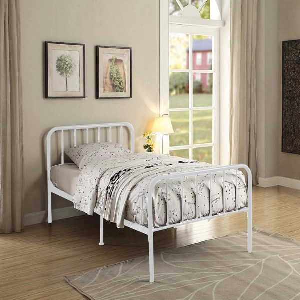 white metal twin bed in a box