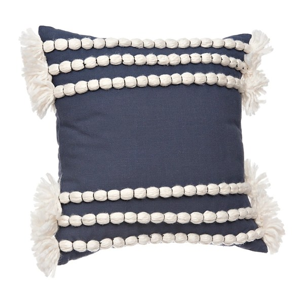 blue and white yarn tassel pillow
