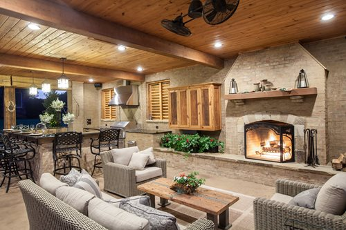 outdoor living space with fireplace Rustic Mississippi Pool House - Landscaping Network