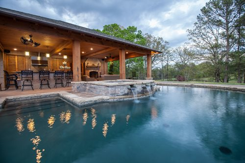pool house with outdoor kitchen Rustic Mississippi Pool House - Landscaping Network