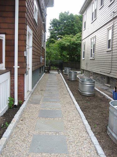 side yard stock tanks - landscaping