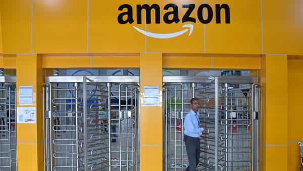 In this file photo an employee of Amazon India walks out of a security gate at Amazon's newly launched fulfilment centre on the outskirts of Bangalore. (AFP)