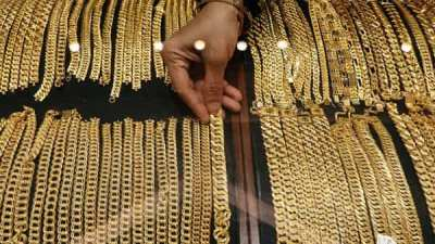 Business News - Gold Prices Rise. Stock Markets Fall.