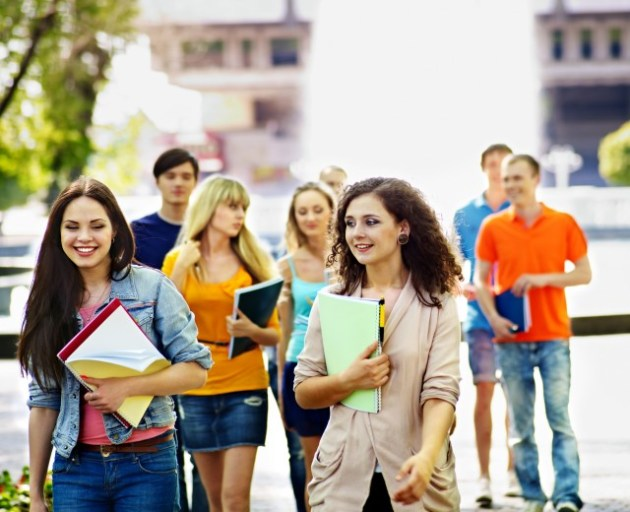 Group happy student with notebook outdoor.