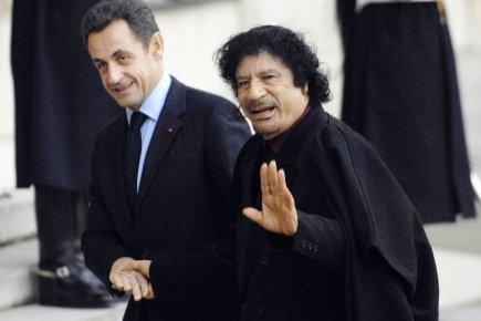 Le président français Nicolas Sarkozy (à gauche) photographié... (Photo: Stéphane De Sakutin, Archives AFP)