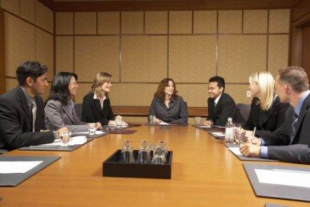 Les femmes qui siègent aux conseils d'administration sont plus susceptibles de... (Photos.com)