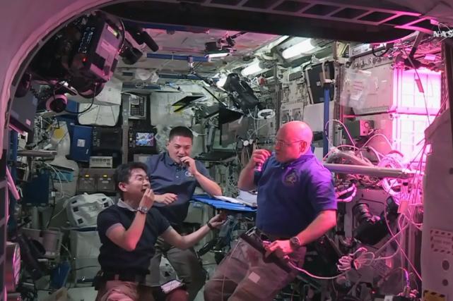 Les astronautes Kimiya Yui, Kjell Lindgren et Scott... (Photo AFP)