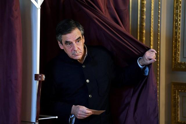 François Fillon a récolté69,5% des voix selon de... (Photo Eric Feferberg, AP)
