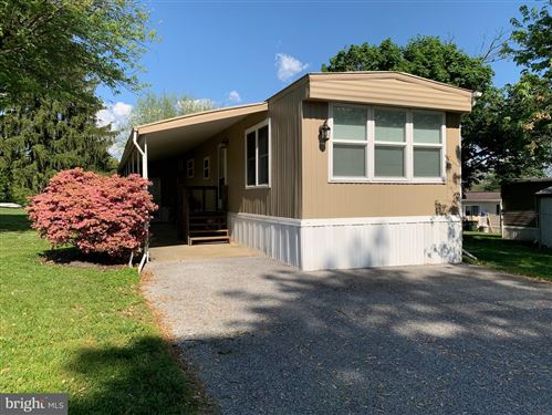 Photo of 235 HOLLY DR, MOUNT WOLF, PA 17347 (MLS # PAYK158564)