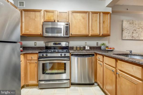 Photo of 7111 WOODMONT AVE #412, BETHESDA, MD 20815 (MLS # MDMC719918)