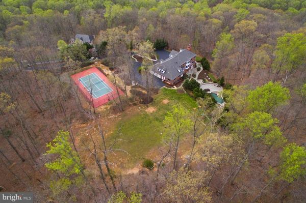 Photo of 10618 BEACH MILL RD, GREAT FALLS, VA 22066 (MLS # 1009925996)