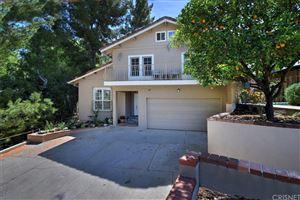 Photo of 21754 YBARRA Road, Woodland Hills, CA 91364 (MLS # SR19071617)