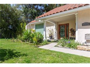 Photo of 21793 PLANEWOOD Drive, Woodland Hills, CA 91364 (MLS # SR19072786)