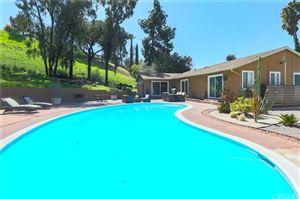 Photo of 5910 LARAMIE Avenue, Woodland Hills, CA 91367 (MLS # SR19062864)
