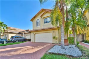 Photo of 11222 NW 53rd Ln, Doral, FL 33178 (MLS # A10601254)