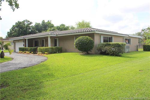 Photo of 5691 SW 8th St, Plantation, FL 33317 (MLS # A10866568)
