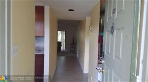 Photo of 2209 S Cypress Bend Dr #108, Pompano Beach, FL 33069 (MLS # F10173033)
