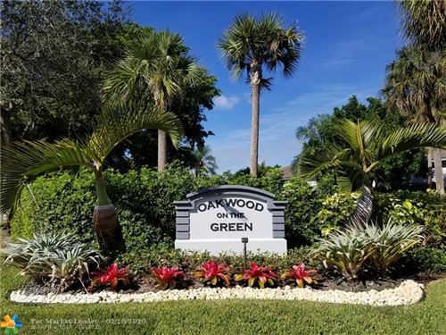 Photo of 9889 Riverside Dr #11-20, Coral Springs, FL 33071 (MLS # F10217230)