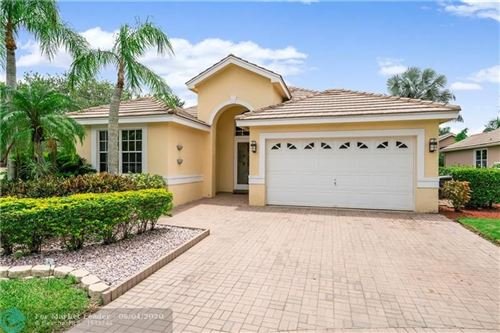 Photo of 12132 Glenmore Dr, Coral Springs, FL 33071 (MLS # F10231244)