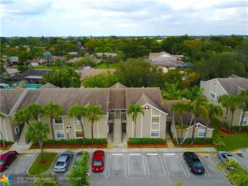 Photo of 9649 Riverside Dr #G4, Coral Springs, FL 33071 (MLS # F10214705)