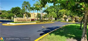 Photo of 5901 NW 61st Ave #108, Tamarac, FL 33319 (MLS # F10203802)