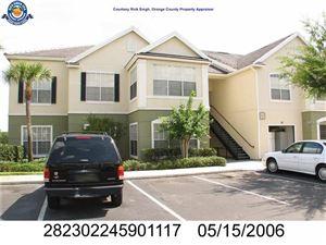 Photo of 2131 LAKE DEBRA DR #1117, ORLANDO, FL 32835 (MLS # O5563100)