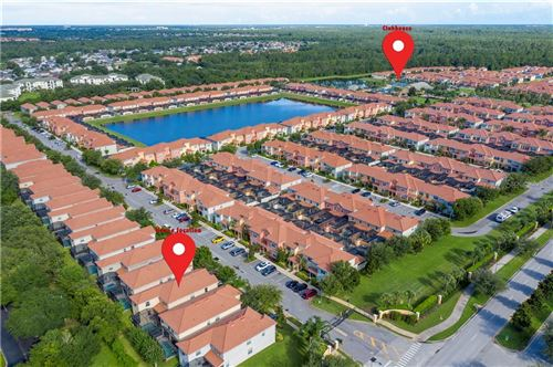 Photo of 8985 CUBAN PALM ROAD, KISSIMMEE, FL 34747 (MLS # O5880103)