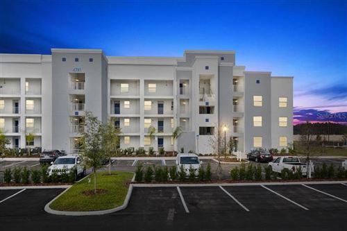 Photo of 4741 CLOCK TOWER DRIVE #106, KISSIMMEE, FL 34746 (MLS # S5027126)