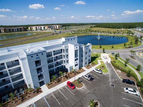Photo of 4721 CLOCK TOWER DRIVE #403, KISSIMMEE, FL 34746 (MLS # S5048161)