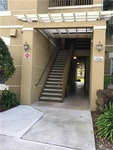 Photo of 3326 ROBERT TRENT JONES DR #301, ORLANDO, FL 32835 (MLS # O5560240)