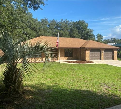 Photo of 1309 TRAIL BY THE LAKE, DELAND, FL 32724 (MLS # O5893484)