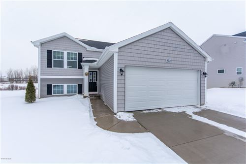 Photo of 302 Vansen Drive, Kent City, MI 49330 (MLS # 20002971)