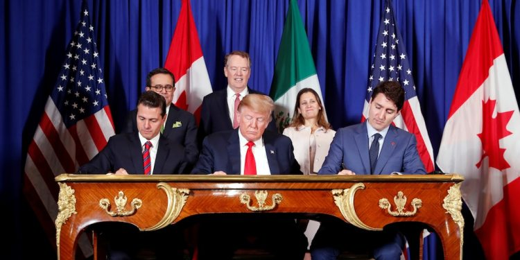 U.S. President Donald Trump, Canada's Prime Minister Justin Trudeau and Mexico's President Enrique Pena Nieto sign documents during the USMCA signing ceremony before the G20 leaders summit in Buenos Aires, Argentina November 30, 2018. REUTERS/Kevin Lamarque - RC15A3E02F60