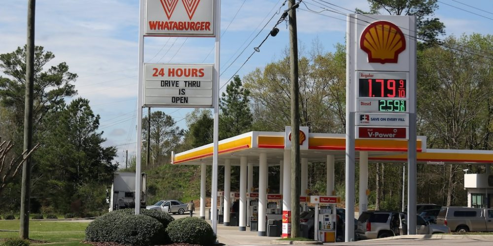 Whataburger and Shell gas station sign shows coronavirus impacts on Alabaster, Alabama on March 22, 2020.