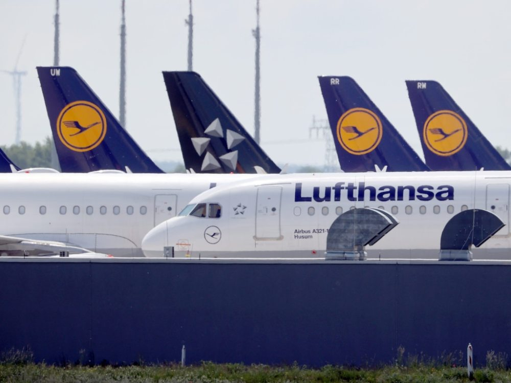 FILE PHOTO: Airplanes of German carrier Lufthansa are parked at the Berlin Schoenefeld airport in Schoenefeld, Germany, May 26, 2020. REUTERS/Fabrizio Bensch