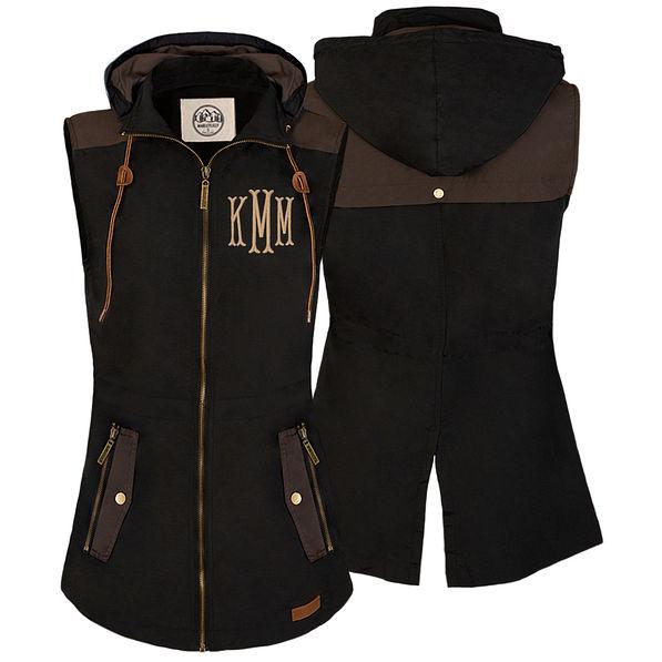 monogrammed utility vest in black with fishtail monogram