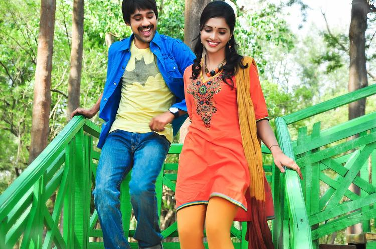 Varun And Sanchita Nice Look With Cute Smiling Movie Still
