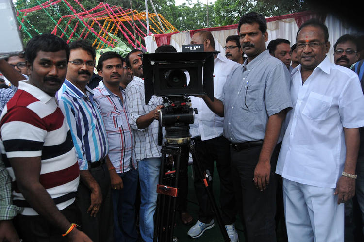 Team Members With Camera Posed ForCamera At Pelli Pusthakam Movie Launch Event