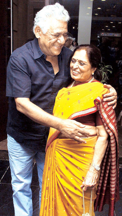 Om Puri Gives A Buddy Hug To Sarayu Doshi At Devangana Kumar Art Exhibition